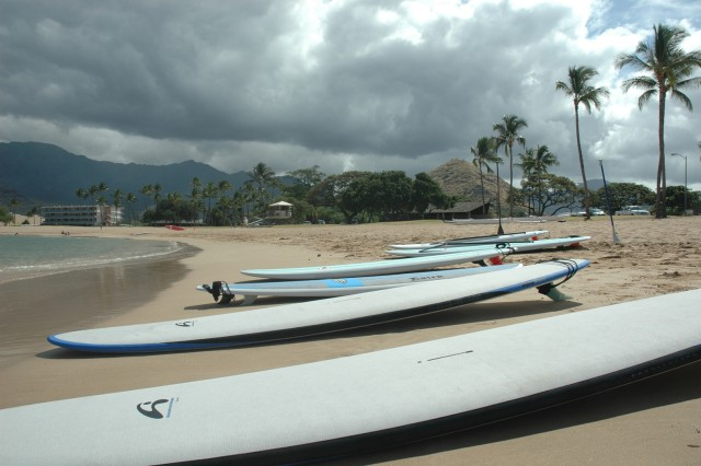 WAIANAE, Hawaii - Paddleboards line Pokai Beach prior to a paddling lesson for Blue Star Card holders, April 16. The Waianae Mountain Range created a beautiful background for stand up paddlers during the Blue Star Card day at the beach.