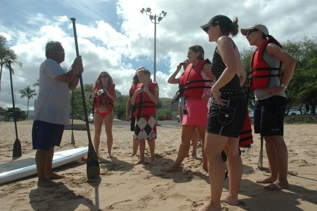 WAIANAE, Hawaii - Pete Bautista, (left) program specialist for ODR explains safety techniques to paddlers. Blue Star Card holders enjoyed an introduction to the art of stand up paddling with a combined effort from FMWR and Outdoor Recreation, April 16.