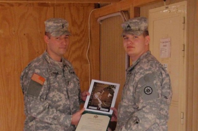 Sgt. David Carmody, a native of Altoona, Pa., receives his promotion certificate from 1st Lt.  Floyd Jordan, an Etters, Pa. native at Camp Stryker, Iraq. Both Soldiers are deployed with the 3rd Detachment, 374th Financial Management Company, 10th Sustainment Brigade in support of Multi-National Division - Baghdad.