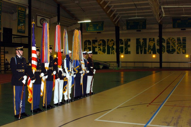 An Armed Forces Color Guard stands ready to present the colors at the 2nd annual Joint Drill Exhibition. The performances were held at George Mason University Sunday.