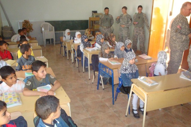 Iraqi children at the Eternal Hope Orphanage in Samawa, Iraq wait patiently for the 167th Combat Sustainment Support Battalion Soldiers to pass out toys and supplies, April 13.