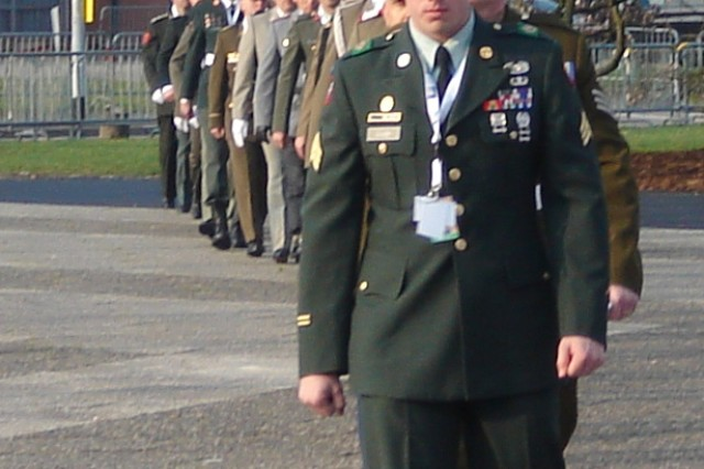 Brussels Soldier Sgt. Justin Eader leads the procession of Soldiers from all NATO nations into the NATO Summit.