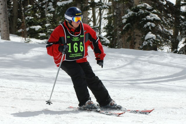 Army veteran Joel Hunt skis at the Disabled Veterans Winter Sports Clinic. He was a demolition specialist in Iraq who sustained a traumatic brain injury from an IED explosion.