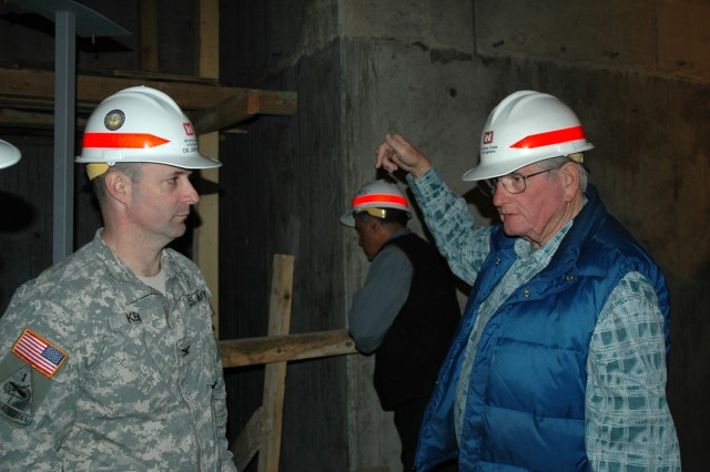Charles Truesdell (right), a quality assurance representative with the Europe District's Turkey Resident Office, explains the progress on the $5.2 million Consolidated Communications Facility on Incirlik Air Base, Turkey, to Col. John Kem, Europe District commander, during a visit in February. The building is on schedule to be completed this spring.