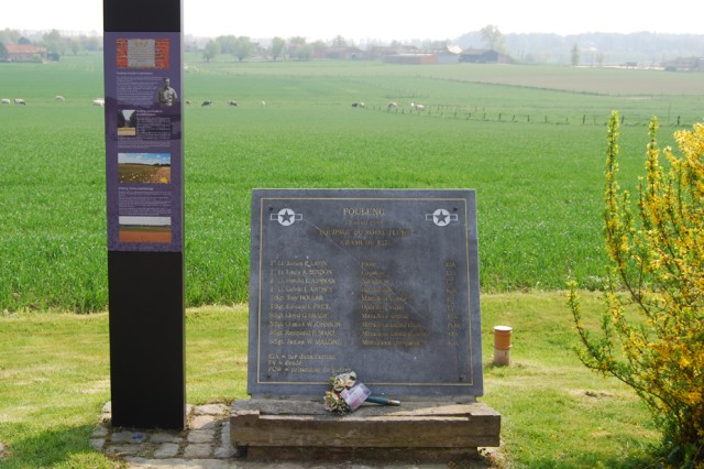 Commemorative plaque at Fouleng, Silly, in Belgium, honoring the crew members of the Royal Flush that crashed in the field in the background on April 13, 1944.