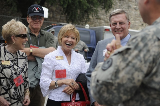 Civilian Aides to the Secretary of the Army (from left) T.C. Freeman, from central Kentucky; Jean Shine from central Texas and husband, Bill Shine, react to a HAZMAT briefing from the Texas National Guard during a demonstration at Fort Sam Houston in San Antonio, Texas. More than 80 civilian aides, special government employees who agree to serve as representatives of the Secretary of the Army without salary, wages, or related benefits, representing all states and territories, met in San Antonio for their annual national conference.