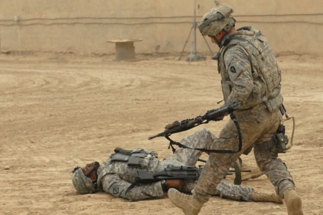 BAGHDAD - Sgt. Jose Leasure, the sergeant of the guard at an entry control point on Victory Base Complex and native of Brunswick, Ga., serving with Troop A, 1st Squadron, 124th Cavalry Regiment, 56th Infantry Brigade Combat Team,  reacts to a wounded Soldier during a mass casualty training exercise held on VBC on Apr. 24. The training exercise was executed to bring together and coordinate the efforts of more than 20 agencies on VBC in order to foster better relationships and communication between the groups.