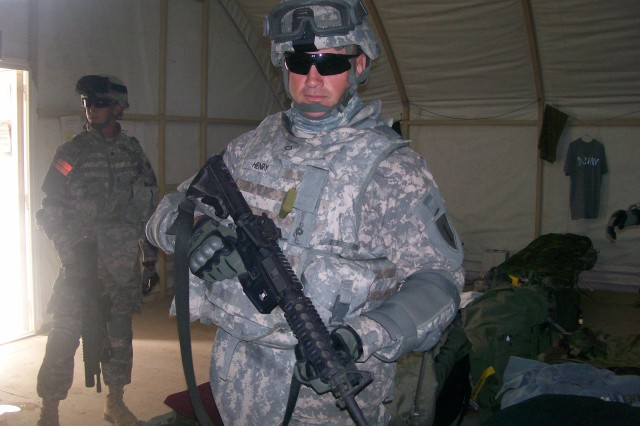 BAGHDAD- Pfc. Paul Henry, of Marion, Ill., enlisted in the U.S. Army at the age of 42. Henry was a car salesman before he decided to enlist in the Army and train with recruits who were half his age. He is now deployed to Iraq stationed at Forward Operating Base Mahmudiyah, south of Baghdad and is assigned to the 1st Combined Arms Battalion, 63rd Armored Regiment, which is currently attached to the 2nd Brigade Combat Team, 1st Armored Division.
