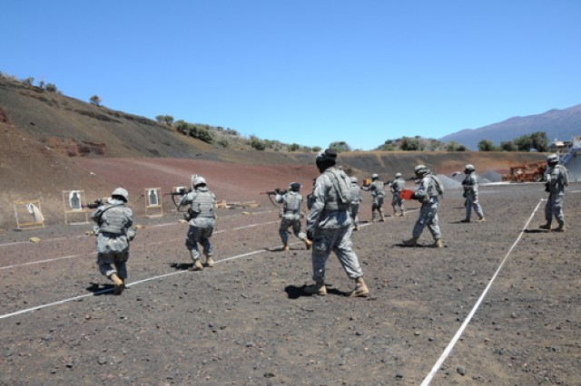 """Soldiers from the 524th Combat Sustainment Support Battalion conduct reflexive-fire training at Pohakuloa Training Area April 14 in Hawaii.  The Soldiers are preparing for a deployment this summer."""""""