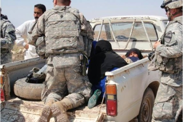 A new baby boy is delivered with the assistance of U.S. Army medics near Dalish, Iraq, April 21. Spc. Nicholas Martin and Pfc. Michael Guerrero, both medics with 4th Squadron, 9th Cavalry Regiment, 2nd Brigade Combat Team, 1st Cavalry Division, helped deliver the child in the back of a truck on the side of a road.