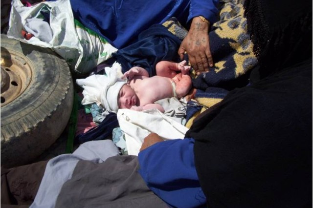 A new baby boy opens his eyes for the first time after being delivered with the assistance of U.S. Army medics near Dalish, Iraq, April 21. Spc. Nicholas Martin and Pfc. Michael Guerrero, both medics with 4th Squadron, 9th Cavalry Regiment, 2nd Brigade Combat Team, 1st Cavalry Division, helped deliver the child in the back of a truck on the side of a road.