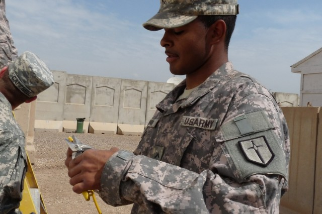 BAGHDAD -Camden, S.C. native, Pvt. Brandon Sharper, a communications specialist with the 46th Engineer Combat Battalion, 225th Eng. Brigade, works with communications cable on Camp Liberty.