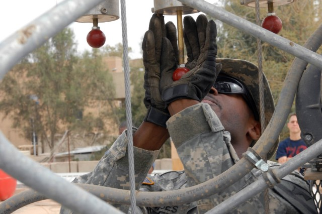 BAGHDAD - Detroit native, Staff Sgt. Bryan Moses, noncommissioned officer in charge for the base defense operating cell (BDOC), 115th Brigade Support Battalion, 1st Brigade Combat Team, 1st Cavalry Division engages the brakes in order to lower the raid tower for a routine cleaning April 26 on Joint Security Station War Eagle, north of Baghdad.