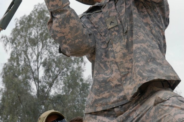 BAGHDAD - Brewster, N.Y. native, Pvt. Michael Slocum, raid camera operator for the base defense operating cell (BDOC), 115th Brigade Support Battalion, 1st Brigade Combat Team, 1st Cavalry Division checks the tension in the wires of the raid tower April 26 on Joint Security Station War Eagle, north of Baghdad.