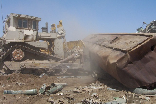 BAGHDAD - One of the largest bulldozers in the military arsenal, the D-9, driven by Command Sgt. Maj. Joe Major of the 225th Engineer Brigade, 1st Cavalry Division, pushes debris around Sather Airbase, located on Victory Base Complex, April 27. U.S. engineers, with the assistance of the Government of Iraq, plans to expand the facilities at Sather Airbase to handle the projected increase of commercial air traffic in the upcoming years.