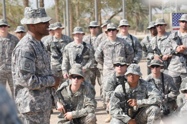 """BAGHDAD - Command Sgt. Maj. King O. Parks, senior enlisted leader of the 3rd Brigade Combat Team, 82nd Airborne Division, Multi-National Division -Baghdad, told paratroopers assigned to the 5th Squadron, 73rd Cavalry Regiment how proud he was of them. """"It never seizes to amaze me how much you do and how well you do. You are phenomenal,"""" said Parks. Eighty-two paratroopers reenlisted during a ceremony April 23 at the Cross Sabers in Baghdad."""