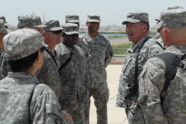 BAGHDAD - Louisiana's adjutant general, Maj. Gen. Bennett Landreneau (right), visits with Soldiers from 225th Engineer Brigade from Pineville, La., at Camp Liberty April 22. The former commander of the 225th Eng. Bde., said he was humbled to visit with the Louisiana Soldiers serving honorably in Baghdad.