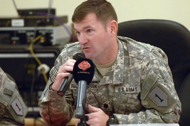 BAGHDAD - Lt. Col. John Richardson, IV, a native of Tallahassee, Fla., commander, 5th Squadron, 4th Cavalry Regtiment, 2nd Heavy Brigade Combat Team, 1st Infantry Division, Multi-National Division - Baghdad, speaks to several members of the Iraqi media at the Freedom Rest Center in Baghdad April 26. Richardson, whose squadron operates in the Mansour district, said he and his Iraqi Security Force partners have seen a great improvement in security.