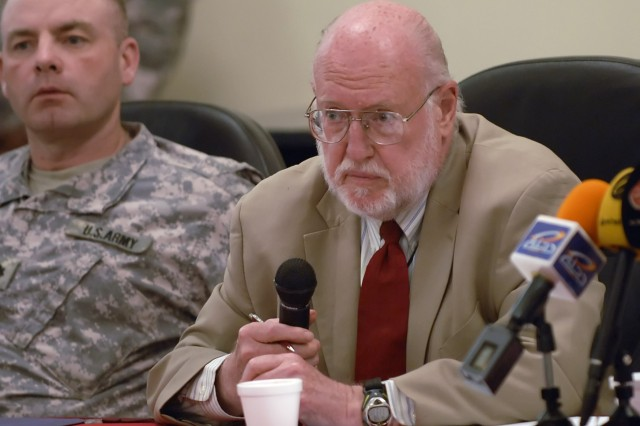 BAGHDAD - Ambassador John Bennett, leader of the embedded Provisional Reconstruction Team, alongside Lt. Col. John Vermeesch, IV, commander, 1st Combined Arms Battalion, 18th Infantry Regiment, 2nd Heavy Brigade Combat Team, 1st Infantry Division, Multi-National Division - Baghdad, answers questions from members of the local Iraqi media in the International Zone April 26.