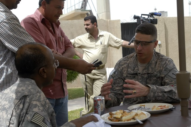 BAGHDAD - Members of the Iraqi media interview Col. Joseph Martin, a native of Dearborn, Mich., commander, 2nd Heavy Brigade Combat Team, 1st Infantry Division, Multi-National Division - Baghdad over lunch at the Freedom Rest Center April 26. Martin answered questions pertaining to the security agreement, civil capacity and the recent bombings in Kadamiyah.