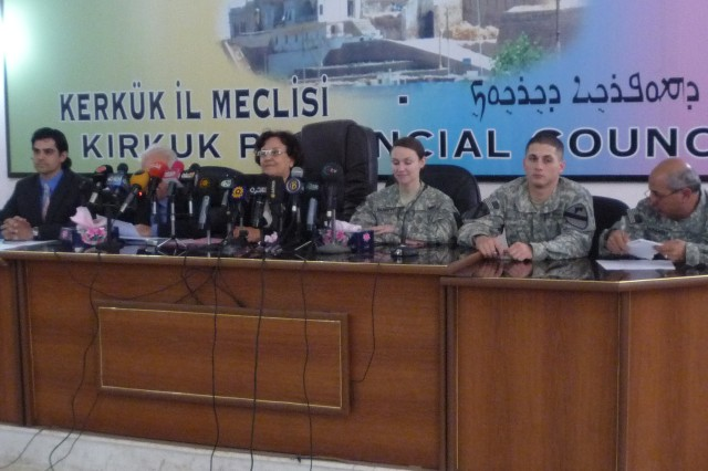 Fawzie Abdullah Awanis, the Kirkuk Deputy Director General of Education, sits with U.S. military advisors and members of Forward Operating Base Warrior's Provincial Reconstruction Team, at a conference in downtown Kirkuk city, Iraq, April 14. The meeting discussed the delivery of 250,000 books to 900 schools