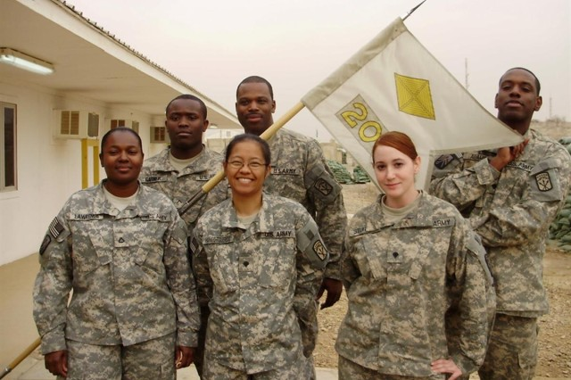 CAMP LIBERTY, Iraq - Members of Alpha Detachment, 9th Financial Management Company, 10th Sustainment Brigade Troops Battalion, 10th Sustainment Brigade, newly attached to headquarters, 208th FM Co., assist the finance support mission at Camp Liberty, Iraq. (From left to right) Pfc. Cassandra Lawrence, a Kingston, Jamaica native; Pvt. Reginald Garner, Mobile, Ala.; Spc. Kealohalani Hanato, of Hilo, Hawaii; Sgt. Ruben Carpenter, a native of Chesapeake, Va.; Spc. Tabitha Sturgil, from Dyer, Tenn.; and Spc. Jermel Adams, a native of San Antonio.