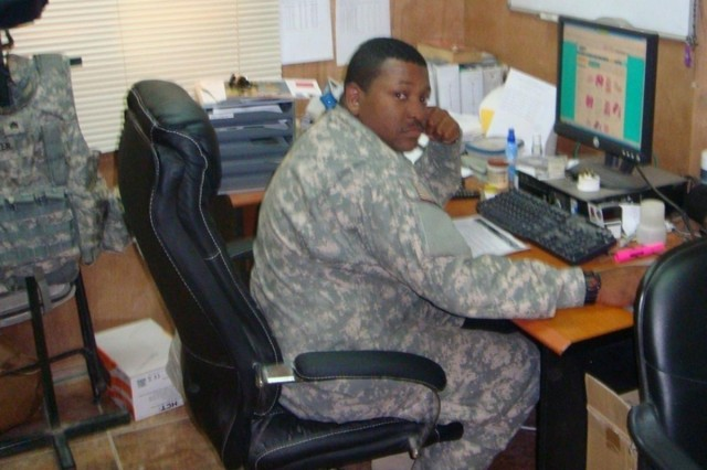 CAMP LIBERTY, Iraq - Sgt. Lester Standifer, Orlando, Fla., and military pay review section noncommissioned officer in charge, reviews Soldiers pay for accuracy on a daily basis at Camp Liberty, Iraq. Standifer is assigned to Alpha Detachment, 125th Financial Management Company, 10th Sustainment Brigade Troops Battalion, 10th Sustainment Brigade.