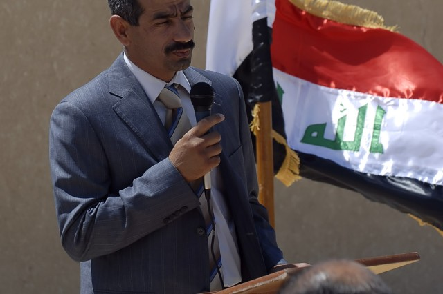 BAGHDAD - Abbas, the chairman of the Abu Ghraib District Council, speaks to attendees of the Khandari Water Treatment Facility Opening Ceremony in Abu Ghraib April 27. The new facility purifies close to eight million gallons of water every day and will give about one thousand families in the Khandari area clean water.