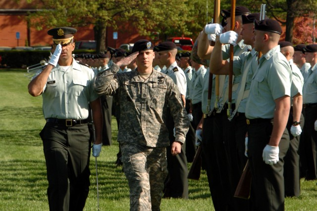 Sgt. 1st Class Strate Flessas, the Army's 2008 Career Counselor of the Year, reviews the troops with Lt. Col. Robert Forte, the 1st Battalion, 3rd U.S. Infantry Regiment (the Old Guard).