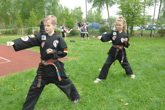 Christopher and Caitlin Holland are the first twins to earn black belts in Karate Tech Mixed Martial Arts in the Kaiserslautern military community.