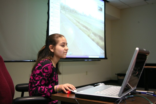 Alexis Ramos, 10, maps the address to her school to demonstrate satellite technology during the U.S. Army Space and Missile Defense Command/Army Forces Strategic Command's Bring Your Child to Work Day on April 23. Alexis is the daughter of Julio Ramos, systems analyst.