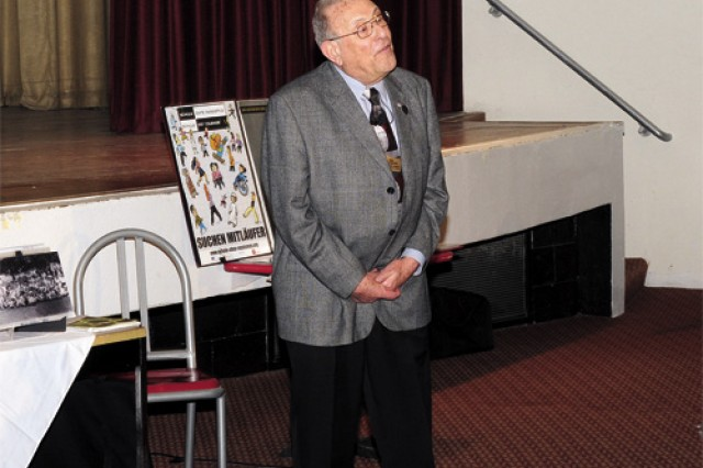 Holocaust survivor and author Alexander Lebenstein speaks during the Fort Eustis Holocaust Days of Remembrance observance April 22 at Jacobs Theater.