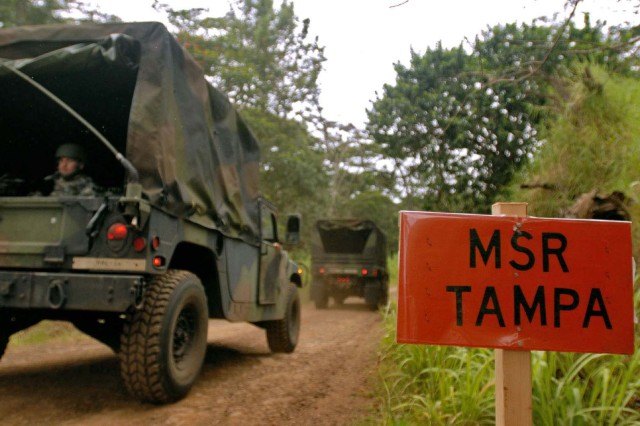 Vehicles belonging to the Special Troops Battalion, United States Army, Pacific, drive along Main Supply Route Tampa during convoy operations training at Schofield Barracks, April 29. The Soldiers trained on procedures for reacting to improvised-explosive devices during convoy operations.