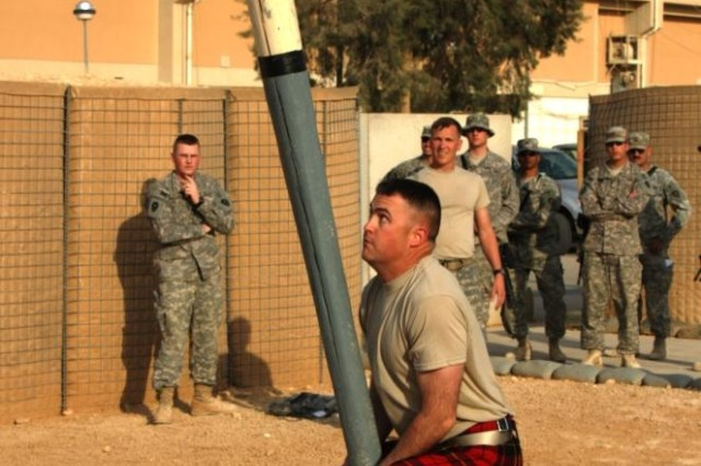 Texas Army National Guard's, Maj. Mike Wallace, 2nd Battalion, 142nd Infantry Regiment executive officer, positioned to launch a caber during the Tartan Day festival at Al Asad Air Base, Iraq, April 6.