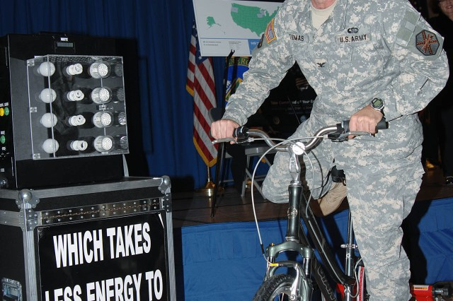 Fort Meade Installation Commander Col. Daniel L. Thomas takes a spin on a Light Bulb Comparison Energy Bike April 22 as part of an Earth Day demonstration at Youth Services.