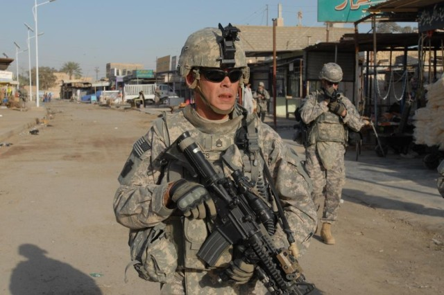 TAJI, Iraq - Staff Sgt. Steven Jones,  from Bradford Pa., leads a patrol in the Taji Market with Co. C, 1st Battalion, 112th Infantry, 56th Stryker Brigade Combat Team, 1st Cavalry Division, Multi-National Division - Baghdad.