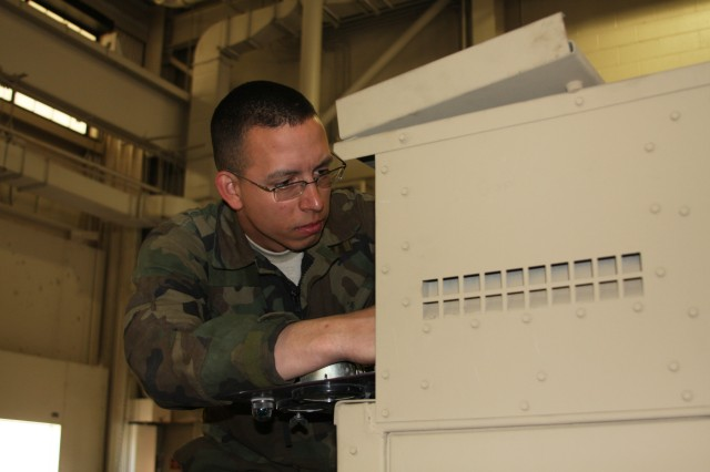 FORT CARSON, Colo.- Sgt. Donald Davidson, Headquarter and Headquarters Company, 43rd Sustainment Brigade, works on a 60k generator. Davidson was named the Army Enlisted Power Generation Technician of the year.