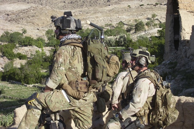 Members of Operational Detachment Alpha 3336 of the 3rd Special Forces Group recon the remote Shok Valley of Afghanistan, where they fought an almost seven-hour battle with terrorists in a remote mountainside village. Patches and insignia may be altered for security reasons.