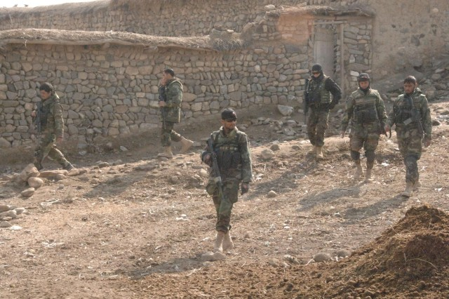 Afghan National Army commandos from the 203rd Kandak search a village during security operations in Khowst Province, Afghanistan, Feb. 7, 2008.