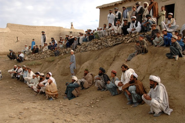 Afghan citizens wait for a truck to be unloaded with humanitarian aid supplies in Panow, Paktika Province, Afghanistan, June 27, 2007. This humanitarian assistance is conducted by coalition forces.