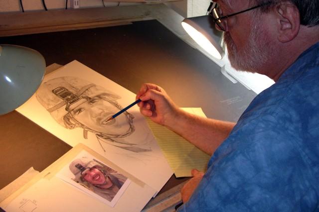 Michael Reagan shades portraits in his home studio.