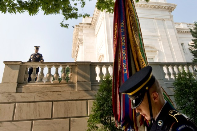 "A Soldier from the 3rd U.S. Infantry Regiment, ""The Old Guard,"" positions the Army flag before a ceremony at the Tomb of the Unknowns in Arlington National Cemetery. Although Arlington is one of two national cemeteries maintained by the Department of the Army, the VA's National Cemetery Administration maintains the other 128 national cemeteries in 39 states (and Puerto Rico) as well as 33 Soldier's lots and monument sites."