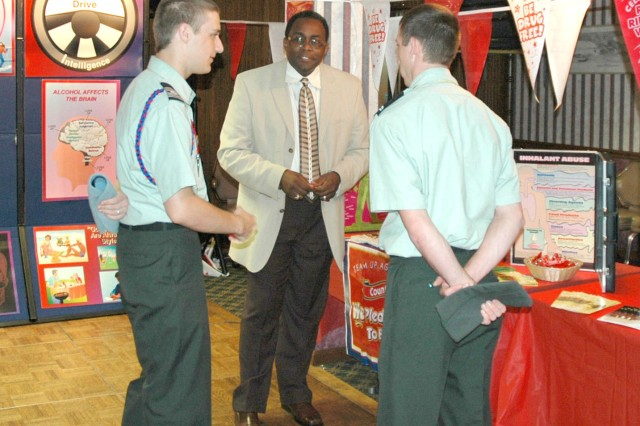 Eric Powell, center, prevention education coordinator for the Community Wellness Center at Fort McPherson  talks with Lamar County High School Army Junior Reserve Officer Training Corps member Casey Bell (left) and an unidentified cadet April 24 during Job Shadow Day at Fort Gillem.