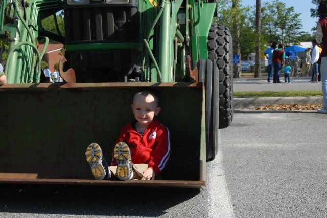 Isaiah Atchison, 3, learns about forklifts at Fort StewartAca,!a,,cs CYSS Wheels Day, April 22, in celebration of Month of the Military Child.