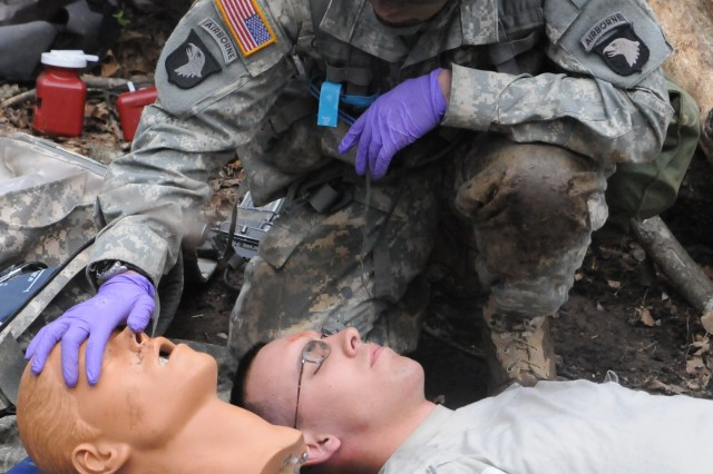 1st Lt. Tom Collins, 1st Battalion, 327th Infantry Regiment, checks the airway for any blockages during EFMB testing.