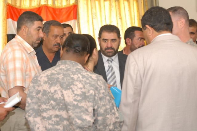 Mutashar Hussain, the new governor of Salah ad Din province, listens to an interpreter during an orientation tour of the Provincial Joint Coordination Center in Tikrit, April 23. The governor, deputy governor, provincial council chairman and deputy chairman all toured the center and got an overview of the joint coordination center concept. There are joint coordination centers in each major city in the province, manned by Iraqi Security Forces, government officials, emergency response managers and U.S. Army Soldiers to coordinate emergency response functions from a consolidated headquarters. (U.S. Army photo by Maj. Cathy Wilkinson)