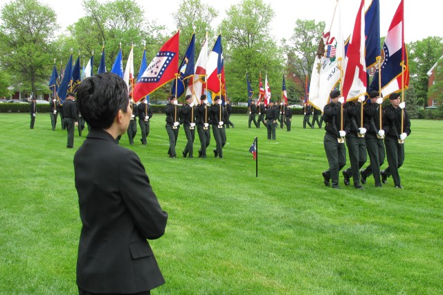 Dr. Heirakuji watches as Soldiers from The Old Guard pass and review carrying our Nation's state and territorial flags.