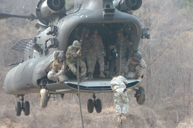 U.S. Special Forces Soldiers assigned to 1st Special Forces Group (Airborne) conduct fast rope training at Damyang, Republic of Korea, March 19, 2009, with members of the ROK Army's 11th Special Forces Brigade. Fast rope training requires Soldiers to rappel from a helicopter as it hovers.