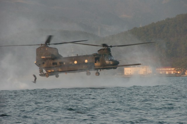 A U.S. Special Forces Soldier assigned to 1st Special Forces Group (Airborne) jumps from an MH-47 Chinook helicopter during maritime operations training near Chinhae, Republic of Korea, March 20, 2009, with ROK Special Operations Forces.
