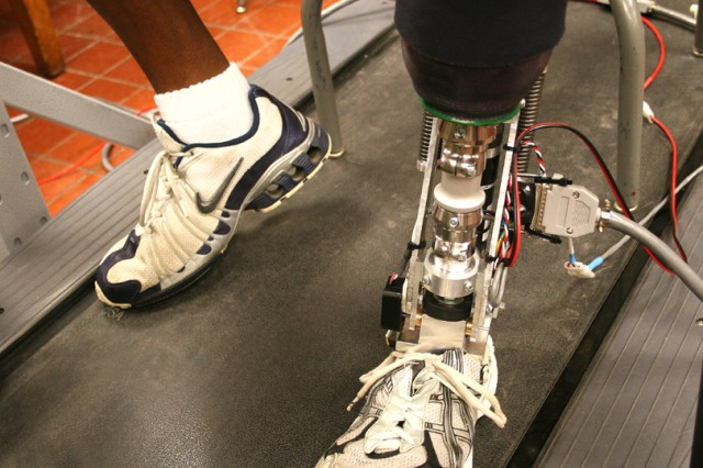 Sgt. 1st Class Pat King from the Walter Reed Army Medical Center Warrior Transition Unit experiments with the cadet-made bionic computerized foot. King said the foot felt a bit wobbly so seniors Ian Jones, Sarah Goss and Joe Marshall took the foot to fabrication to find the problem, April 22.